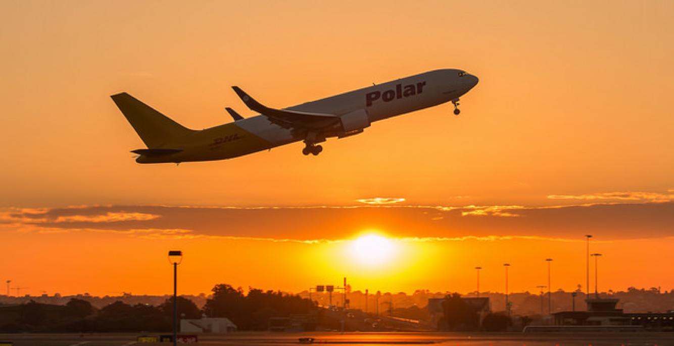 Airplane Liftoff at Dawn
